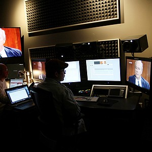 Izzy DeHerrera and Mason Seay work in an editing bay at the Golf Channel on the Arnold Palmer documentary.