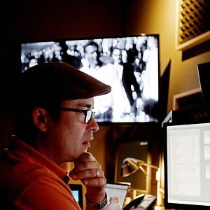 Izzy DeHerrera pays close attention to some final tweaks of the Golf Channel's Arnold Palmer documentary.