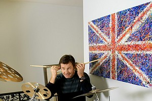 Nick Faldo at his home in Winter Park, Fla. with a set of drums given to him by Iron Maiden drummer Nicko McBrain.