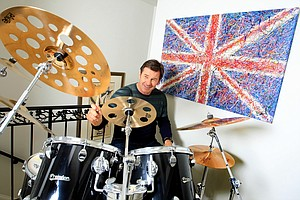 Nick Faldo at his home in Winter Park, Fla., where he enjoys a little time with the drum set, given to him by Iron Maiden drummer, Nicko McBrain.