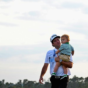 Bubba Watson with his son Caleb after winning his second green jacket at the 2014 Master at Augusta National.