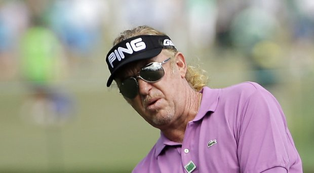 Miguel Angel Jimenez made his Champions Tour debut Friday with a 65 to lead the Greater Gwinnett Championship (shown here during the final round of the 2014 Masters).