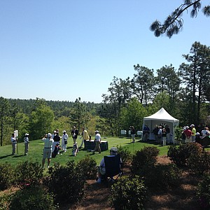 Patrons and volunteers surround the first tee of the 2014 Junior Invitational at Sage Valley.