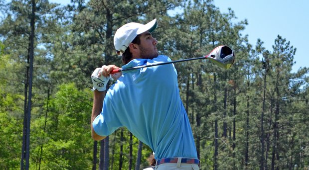 Scottie Scheffler hits a drive on the par-4 18th hole during the first round of the 2014 Junior Invitational at Sage Valley Golf Club in Graniteville, S.C.
