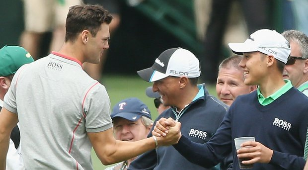Germany's Dominic Foos greets fellow countryman Martin Kaymer during a practice round for the 2014 Masters.