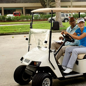 Lydia Ko shares a laugh with Kelly Tilghman during a golf cart driving segment with Golf Channel's Damon Hack acting as a driving instructor during The Morning Drive on Wednesday.