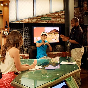 Lydia Ko gets set up with her mics at another interview with Golf Channel.com at Golf Channel studios in Orlando.