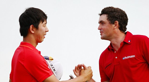 Seung-Yul Noh celebrates his two-shot victory at the Zurich Classic with a handshake from Keegan Bradley.