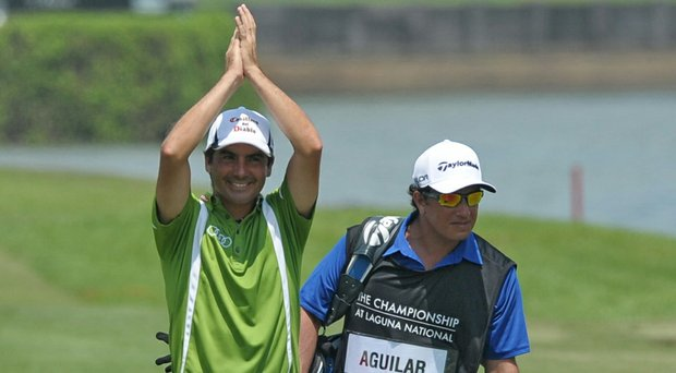 Felipe Aguilar celebrates after holing out on the final hole to win the European Tour's 2014 Championship at Laguna National in Singapore.