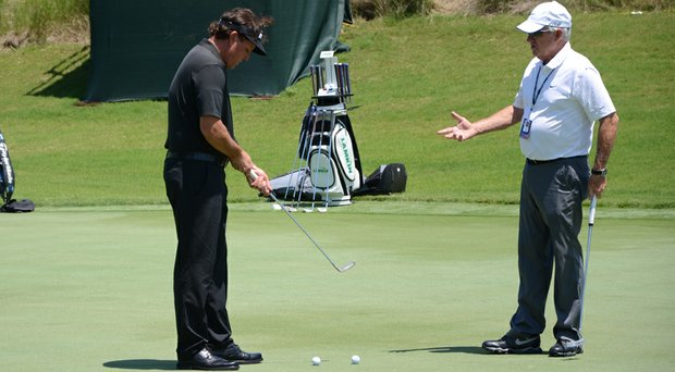 Phil Mickelson works on his putting with Dave Stockton before the PGA Tour's 2014 Players Championship at TPC Sawgrass.