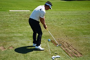 Yang's divots created a series of stripes on the range that matched his Adidas shoes at TPC Sawgrass during practice for the PGA Tour's 2014 Players Championship at Ponte Vedra Beach, Fla.