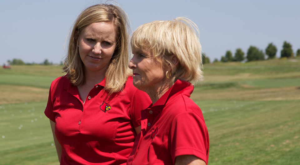 Louisville coach Courtney Trimble, left, is joined by Mary Bryan.