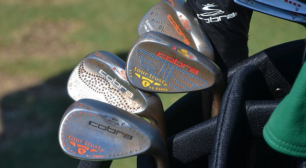 Rickie Fowler's Cobra Tour Trusty wedges have received a lot of custom stamping.