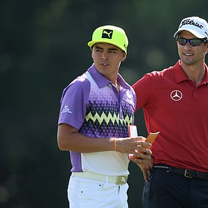 Rickie Fowler and Adam Scott during the second round of the 2014 Players Championship at TPC Sawgrass.