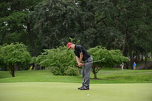 David Boote of Stanford trying to will in a birdie putt on the par-5 sixth hole.