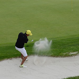 Oregon's Jonathan Woo in the back bunker at the fifth hole in the NCAA regional at Eugene Country Club.