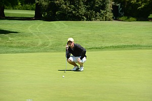 Oregon's Zach Foushee on the looking over a putt on the 18th green.  Foushee with a 2-under 68 led the Ducks to an even par second round and in the hunt for a spot in the NCAA finals.
