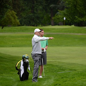 Oregon head coach Casey Martin advising Brandon McIver on his chip shot into the second hole.