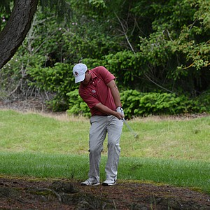 Oklahoma's Michael Gellerman chips out after a poor drive on the sixth hole on Saturday.