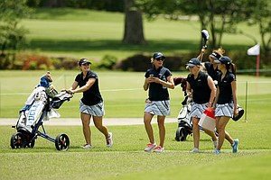 UCLA head coach, Carrie Forsyth, center, with her team at the Women's 2014 Golf Championships at Tulsa Country Club.