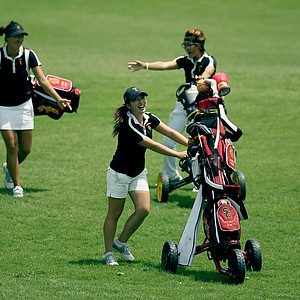Defending Champions, University of Southern California's Kyung Kim, Annie Park, and Karen Chung at the Women's 2014 Golf Championships at Tulsa Country Club.