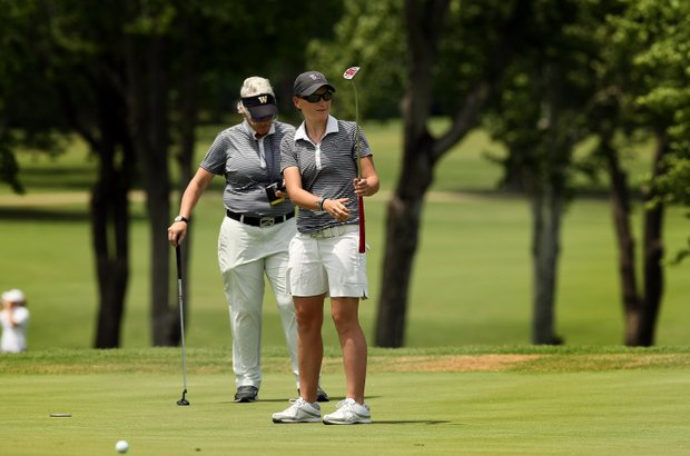University of Washington's Charlotte Thomas and coach Mary Lou Mulflur during Monday's practice round at the Women's 2014 Golf Championships at Tulsa Country Club.