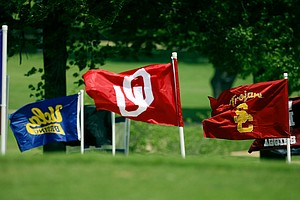 College flags at the Women's 2014 Golf Championships at Tulsa Country Club.