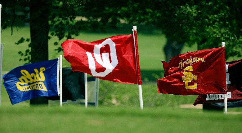 Team flags fly during the 2014 NCAA women's championship at Tulsa Country Club.