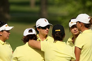 Arizona State head coach, Melissa Luellen, talks with her team after the first round the Women's 2014 Golf Championships at Tulsa Country Club.