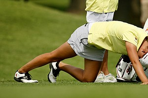 Arizona State's Monica Vaughn stretches her legs at No. 6 during the first round the Women's 2014 Golf Championships at Tulsa Country Club.