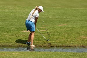 UCLA's Bronte Law took her shoe off to hit her second shot at No. 14 during the first round the Women's 2014 Golf Championships at Tulsa Country Club.