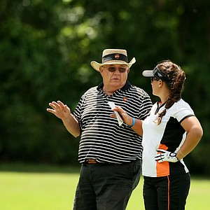 Campbell head coach John Crooks with Tahnia Ravnjak during the first round the Women's 2014 Golf Championships at Tulsa Country Club.