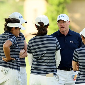 Duke's head coach, Dan Brooks, chats with his team during the first round the Women's 2014 Golf Championships at Tulsa Country Club.