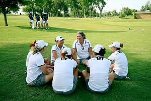 Mississippi State head coach, Ginger Brown-Lemm, talks with her team after the first round the Women's 2014 Golf Championships at Tulsa Country Club.