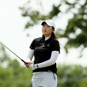 Simin Feng of Vanderbilt watches her tee shot at No. 14 during the first round the Women's 2014 Golf Championships at Tulsa Country Club.
