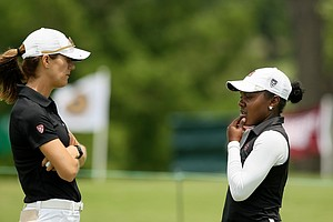 Stanford head coach Anne Walker talks with Mariah Stackhouse during the first round the Women's 2014 Golf Championships at Tulsa Country Club.