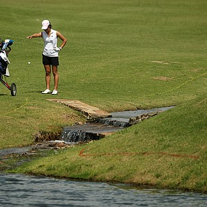 "Duke's Celine Boutier takes a drop near No. 14 named ""Profanity Creek"" during the second round of the 2014 NCAA Division 1 Women's Golf Championships at Tulsa Country Club."