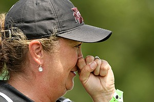 Mississippi State head coach Ginger Brown-Lemm watches play during the second round of the 2014 NCAA Division 1 Women's Golf Championships at Tulsa Country Club.