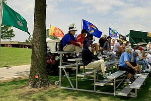 Spectators and teams watch from the stands at No. 18 during the second round of the 2014 NCAA Division 1 Women's Golf Championships at Tulsa Country Club.