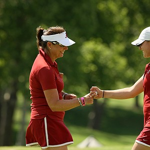 Alabama assistant coach, Susan Rosenstiel, left, with Mia Landegren after making par at No. 5 during Round 3 of the Women's 2014 NCAA Division 1 Golf Championships at Tulsa Country Club.