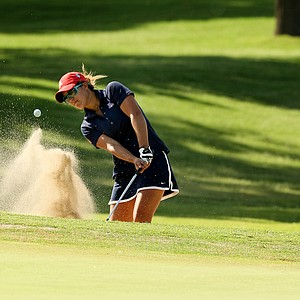 Arizona's Manon Gidali hits out of a bunker at No. 18 during Round 3 of the Women's 2014 NCAA Division 1 Golf Championships at Tulsa Country Club.