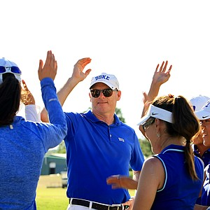 Duke head coach Dan Brooks finishes a team meeting after Round 3 of the Women's 2014 NCAA Division 1 Golf Championships at Tulsa Country Club. Duke has a six shot lead heading into the final round on Friday.