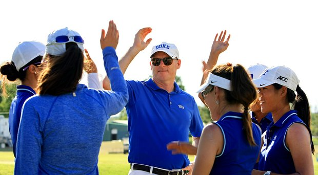 Duke head coach Dan Brooks finishes a team meeting after Round 3 of the 2014 NCAA Division 1 Women's  Golf Championships at Tulsa Country Club. Duke has a six-shot lead heading into the final round on Friday.
