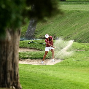 Oklahoma's Alexandra Kaui hits out of the bunker at No. 6 enroute to a 7 at the par 3 during Round 3 of the Women's 2014 NCAA Division 1 Golf Championships at Tulsa Country Club.
