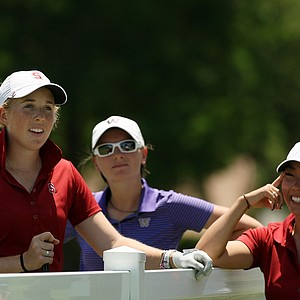 Stanford's Casey Danielson, left, Washington's Charolotte Thomas, center, left, with Stanford assistant coach Lauren Dobashi, during Round 3 of the Women's 2014 NCAA Division 1 Golf Championships at Tulsa Country Club.