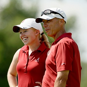 Alabama head coach Mic Potter with Stephanie Meadow during Round 3 of the Women's 2014 NCAA Division 1 Golf Championships at Tulsa Country Club.