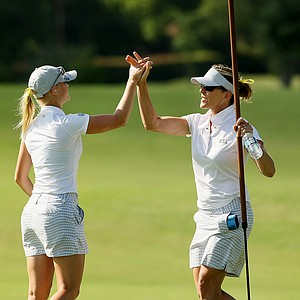 UCLA head coach Carrie Forsyth with Louise Ridderstrom upon making par at No. 18 during Round 3 of the Women's 2014 NCAA Division 1 Golf Championships at Tulsa Country Club.