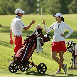 USC assistant coach Justin Silverstein greets Doris Chen at No. 18 during Round 3 of the Women's 2014 NCAA Division 1 Golf Championships at Tulsa Country Club. Doris Chen is in a tie for first with Duke's Celine Boutier for the individual lead.