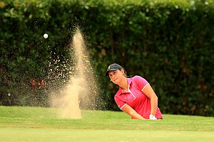 Arizona State's Monica Vaughn hits out of a bunker at No. 2 during the final round of the Women's 2014 NCAA Division 1 Golf Championships at Tulsa Country Club.