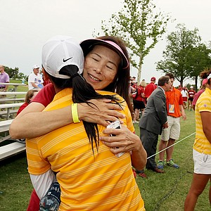 Doris Chen's mom, Yuh-Guey Lin gives her daughter a hug after she won the individual honors at the Women's 2014 NCAA Division 1 Golf Championships at Tulsa Country Club. Guey Lin is recovering from lung cancer and is currently cancer free.